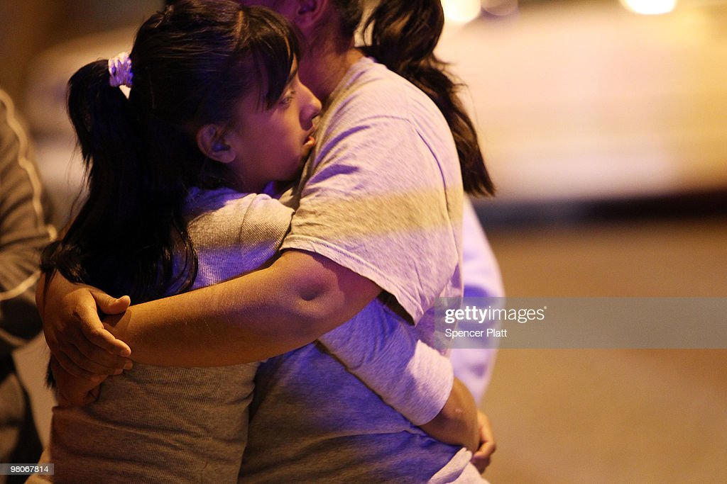 Two woman embrace at a crime scene involving the killing of a 13 year old boy in a car, one of numerous murders over a 24 hour period, March 26, 2010 in Juarez, Mexico. Secretary of State Hillary Rodham Clinton, Defense Secretary Robert Gates, and Homeland Security Secretary Janet Napolitano all visited Mexico on March 23 for discussions centered on Mexico's endemic drug-related violence. The border city of Juarez, Mexico has been racked by violent drug related crime recently and has quickly become one of the most dangerous cities in the world to live. As drug cartels have been fighting over ever lucrative drug corridors along the United States border, the murder rate in Juarez has risen to 173 slayings for every 100,000 residents. President Felipe Calderon's strategy of sending 7000 troops to Juarez has not mitigated the situation. With a population of 1.3 million, 2,600 people died in drug-related violence last year and 500 so far this year, including two Americans recently who worked for the U.S. Consulate and were killed as they returned from a children's party.