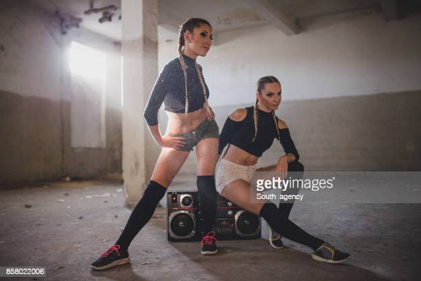 Two woman in empty warehouse