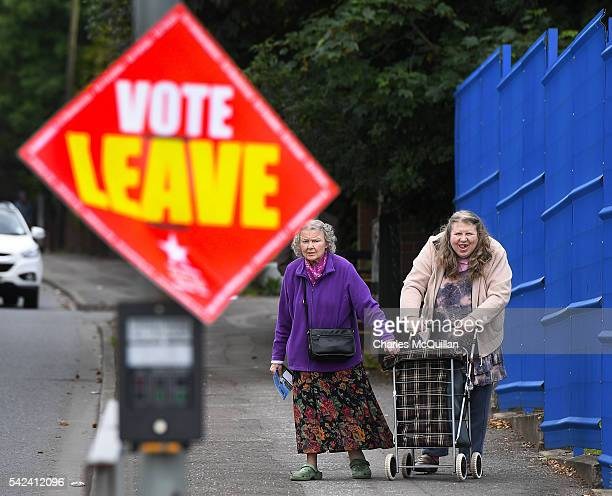 Two woman make their way towards a polling station to vote in the EU referendum on June 23 2016 in Belfast Northern Ireland The United Kingdom has...
