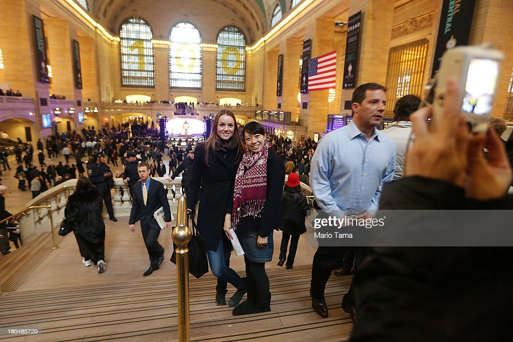 Two woman pose for a picture in Grand Central Terminal during centennial celebrations on the day the famed Manhattan transit hub turns 100 years old on February 1, 2013 in New York City. The terminal opened in 1913 and is the world's largest terminal covering 49 acres with 33 miles of track. Each day 700,000 people pass through the terminal where Metro-Noth Railroad operates 700 trains per day.