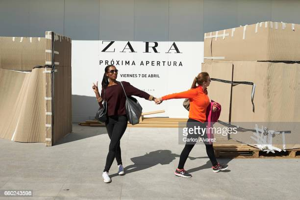 Two woman walk past the front of Zara store on March 29 2017 in Madrid Spain This store will be the biggest Zara store of the world at 6000 square...