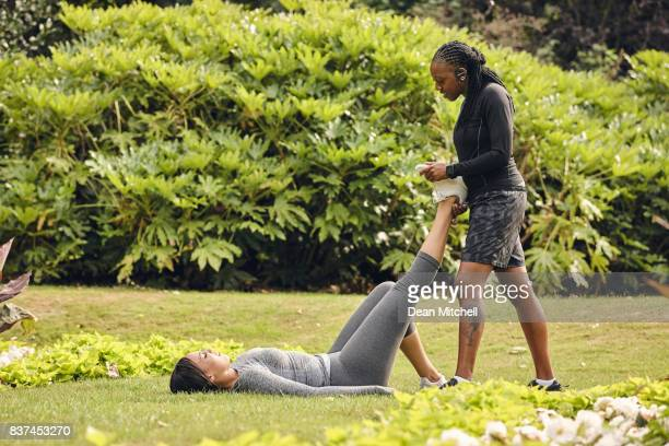 Two woman working out together in park