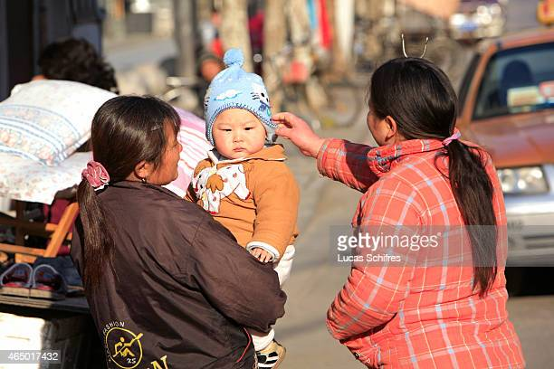 Two women and a baby chat on January 10 2009 in Shanghai China