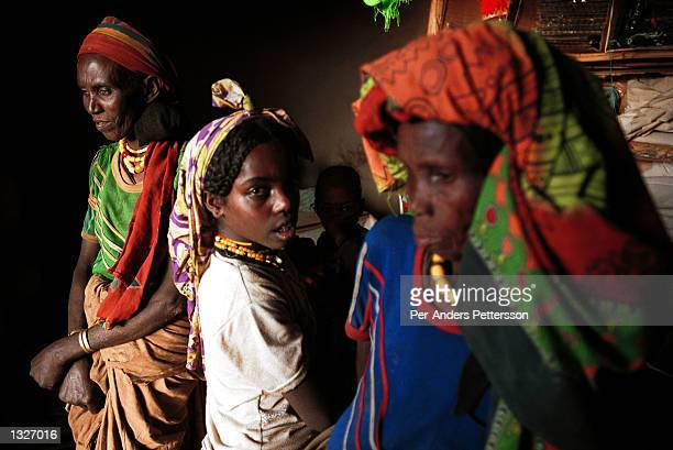 Two women and a girl stand in a shop February 9 2001 in the Erer Valley a rural area in eastern Ethiopia Villagers in the Muslim area have started a...