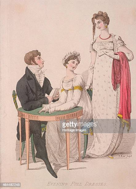 Two women and a man wearing full evening dress c1810 Both women are wearing high waisted empire line dresses and long gloves with the woman on the...