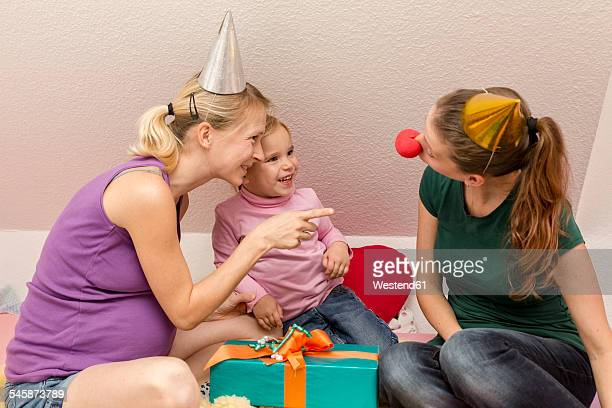 Two women and girl celebrating birthday