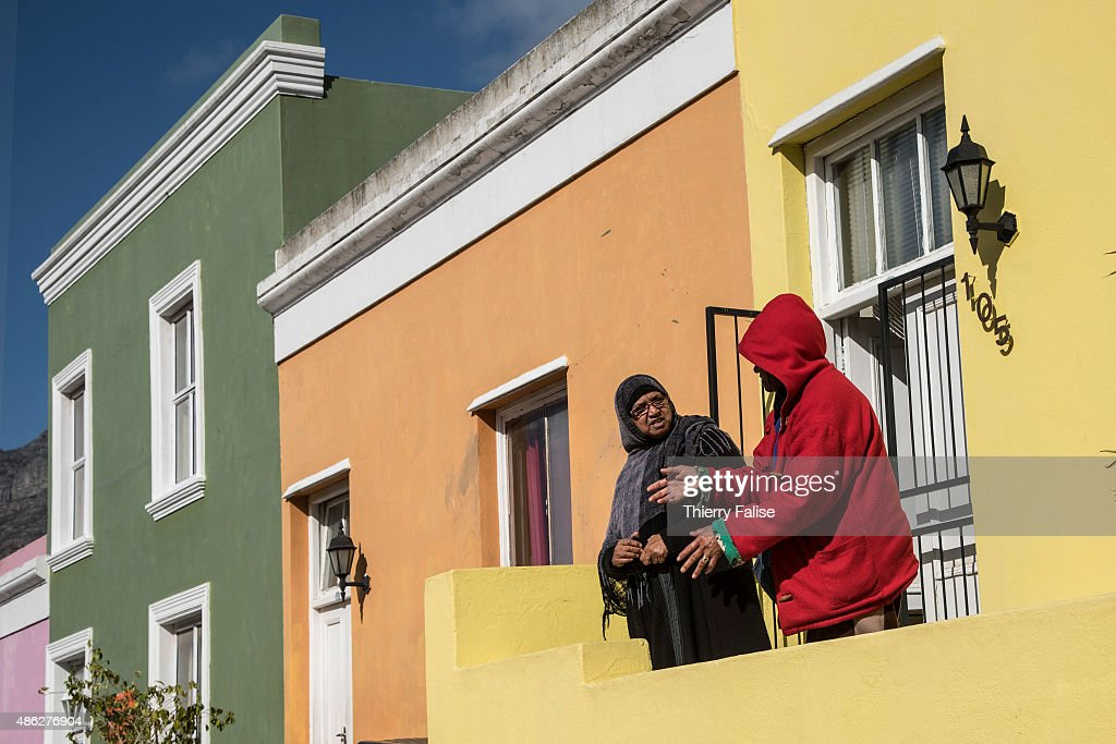 Two women are engaged in a conversation in the Bo-Kaap township, formely known as the Malay Quarter. This township, buit on the slopes of Signal Hill is famous for its colourful architecture and Muslim community.