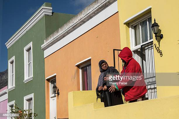 Two women are engaged in a conversation in the BoKaap township formely known as the Malay Quarter This township buit on the slopes of Signal Hill is...