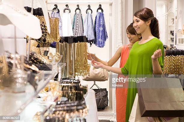 Two women are shopping in the store