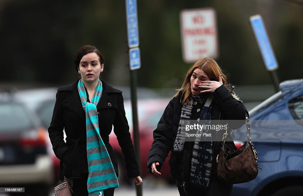 Two women arrive for the funeral services of six year-old Noah Pozner, who was killed in the shooting massacre in Newtown, CT, at Abraham L. Green and Son Funeral Home on December 17, 2012 in Fairfield, Connecticut. Today is the first day of funerals for some of the twenty children and seven adults who were killed by 20-year-old Adam Lanza on December 14, 2012.