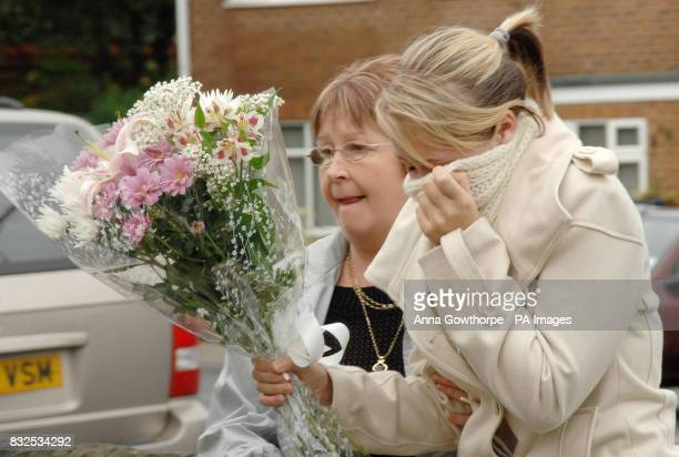 Two women arrive to lay flowers at the home at Horbury near Wakefield West Yorkshire of Neil Shepherd and his partner Ruth Beatson who were...