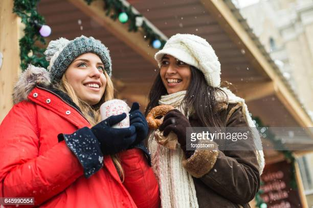 Two women at Christmas market