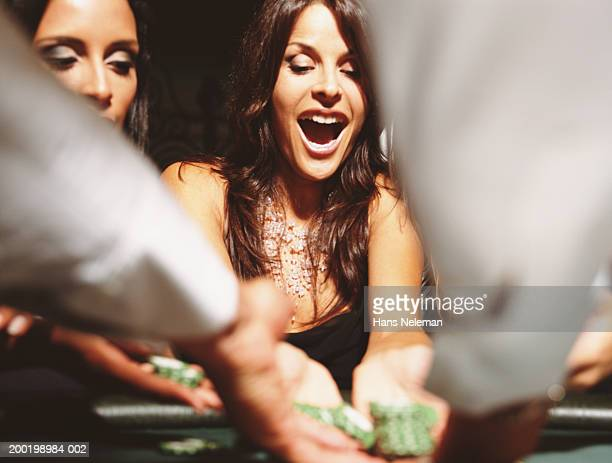 Two women at gaming table collection chips