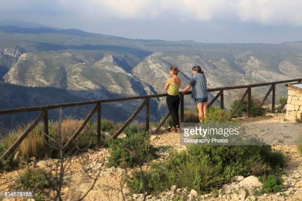Two women at Mirador del Xap viewpoint Vall de Gallinera Marina Alta Alicante province Spain
