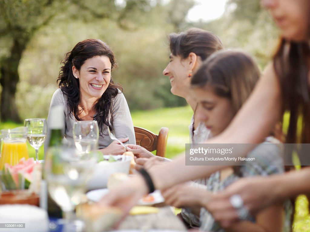Two women at table laughing : Stock Photo