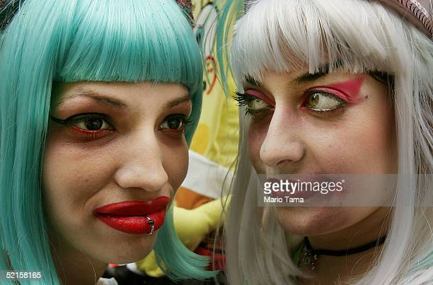 Two Women attend Mardi Gras festivities February 8 2005 in New Orleans Louisiana Mardi Gras is the last carnival celebration before the start of the...
