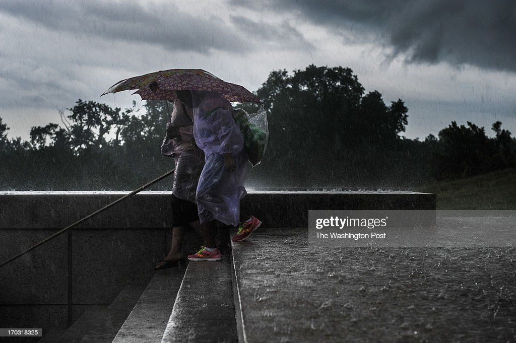 Two women brave the storm as they descend the steps of the Lincoln Memorial on the National Mall. June, 10, 2013 in Washington, DC.