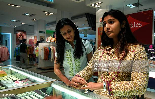 Two women browse at a jewelry counter at a mall in Mumbai India on Thursday Nov 29 2007 India's economy grew last quarter at the slowest pace since...