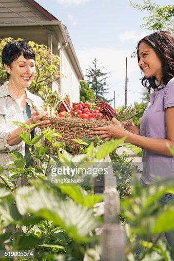 Two women carrying basket