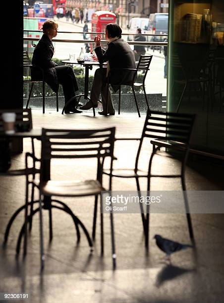 Two women chat during lunch in a cafe in the City of London on October 23 2009 in London England Coffee consumption and 'cafe culture' in developed...