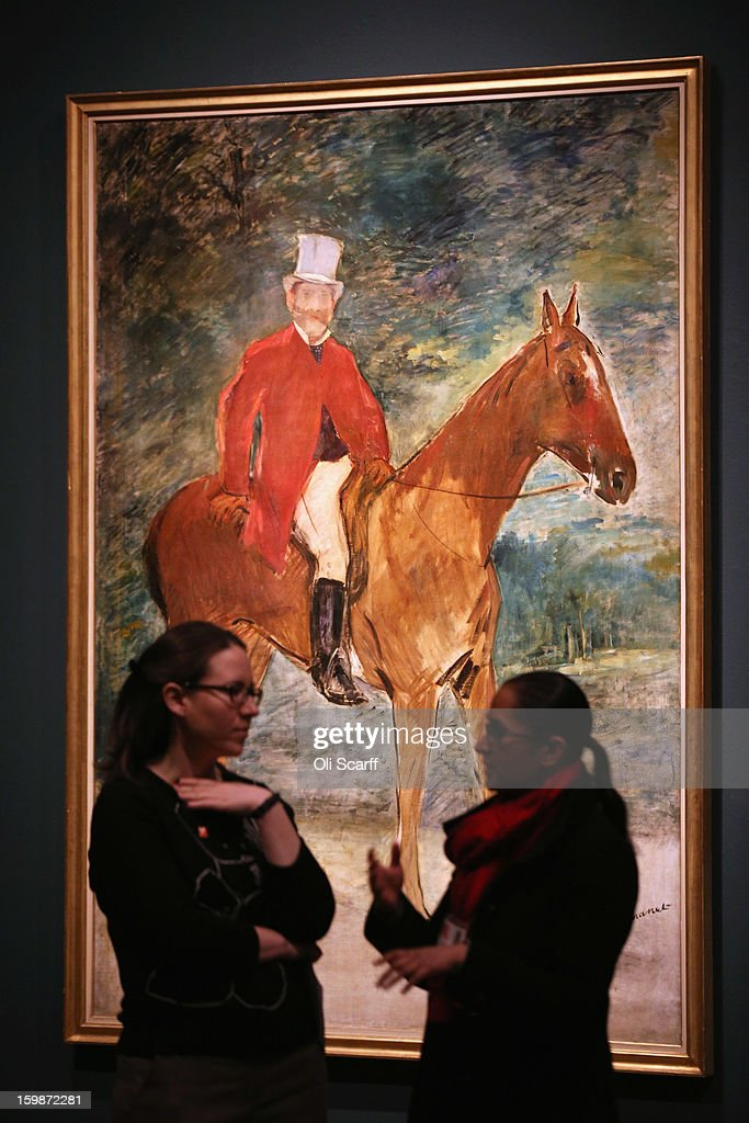 Two women chat in front of a painting by Edouard Manet entitled 'Portrait of M.Arnaud (The Rider)' in the Royal Academy of Arts on January 22, 2013 in London, England. The painting features in the Royal Academy's new exhibition 'Manet: Portraying Life' which displays over 50 paintings spanning his career. The exhibition open to the general public on January 26, 2013 and runs until April 14, 2013.