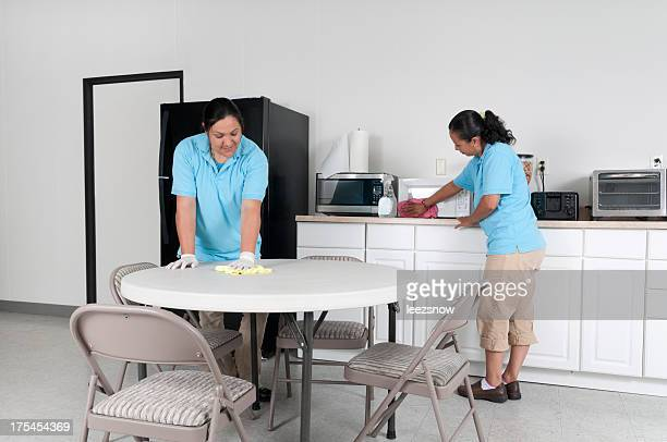 Two Women Cleaning a Corporate Break Room