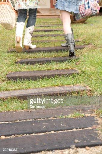Two women climbing up steps : Stock Photo