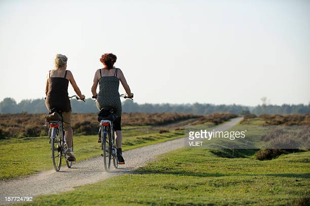 Two women cycling in nature