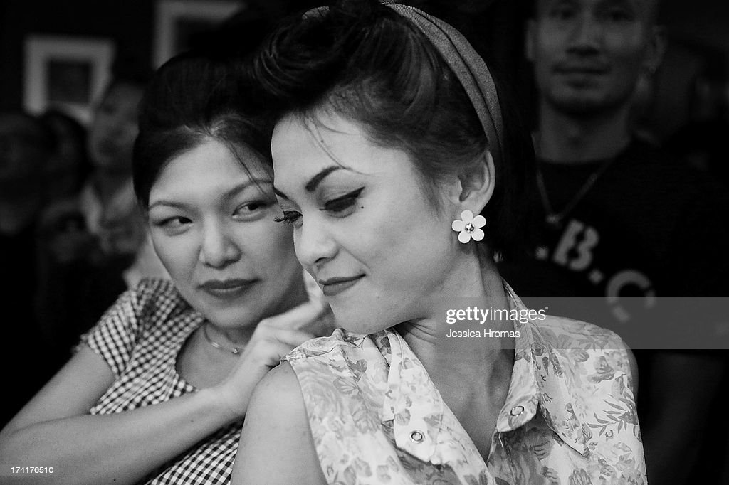 Two women dance together during the Dirty Boogie Rockabilly Festival at the Fring Club on July 20, 2013 in Hong Kong, Hong Kong.