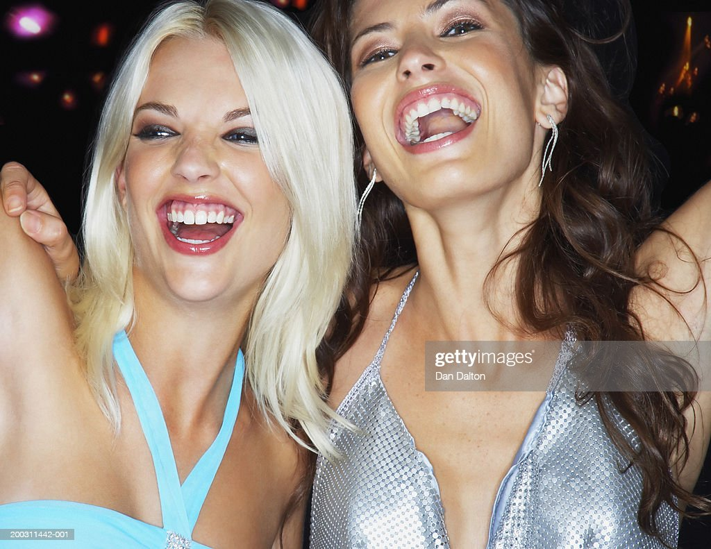 Two women dancing in nightclub, laughing, close-up : Stock Photo