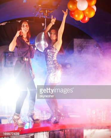Two women dancing on the bar counter. : Stock Photo