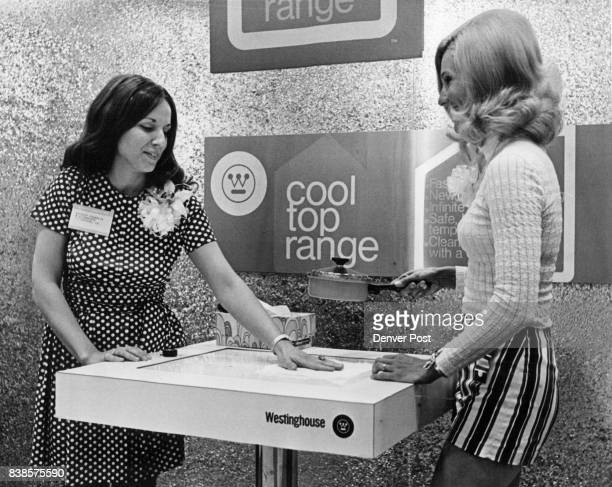 Two women demonstrate a new fasterthangas method of cooking not available yet but in the final stages of marketing by Westinghouse The cool top range...