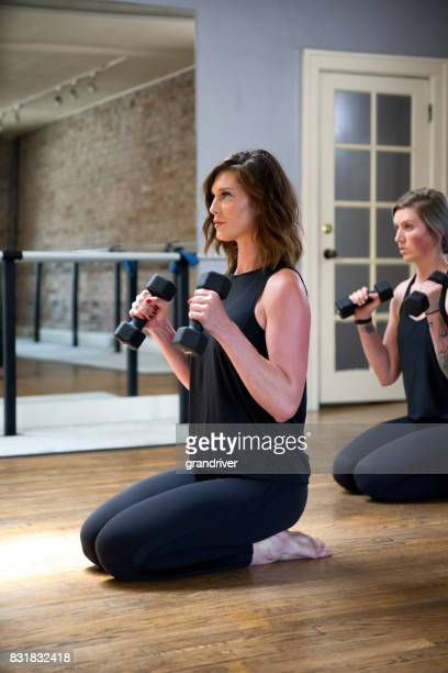 Two Women Doing Barre Dumbbell Workout