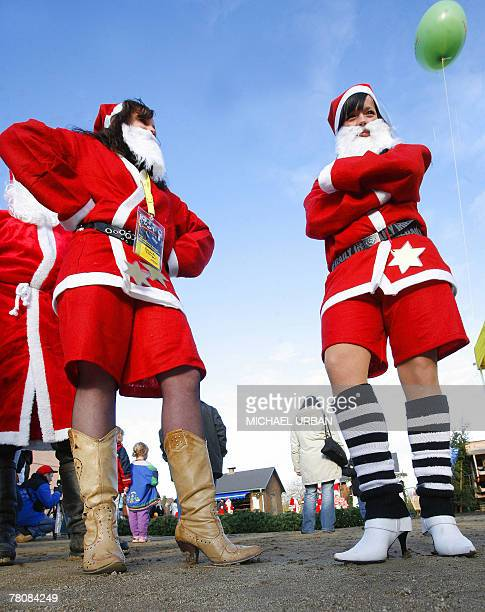 Two women dressed as Santa Claus wear high heeled boots 25 November 2007 during the Santa Claus championships BrandenburgBerlin in Potsdam eastern...