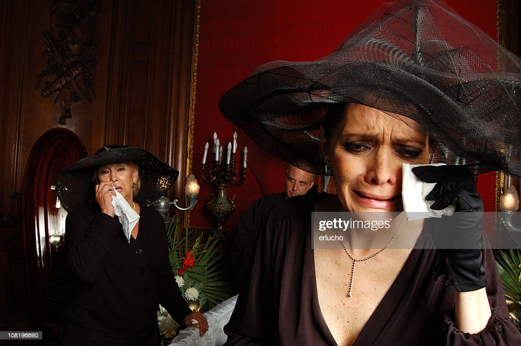 Two Women Dressed in Black and Crying at Funeral : Stock Photo