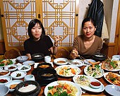 Two women eating Korean food