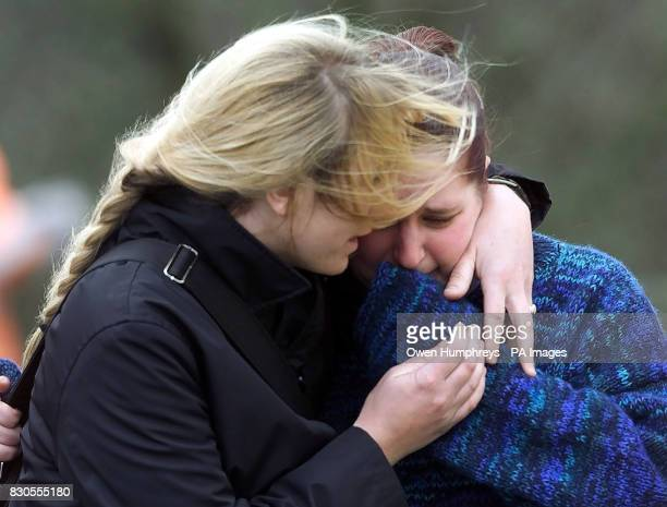 Two women embrace one another at the scene of the railway accident near Selby Yorkshire in which 13 people died The crash happened after a freight...