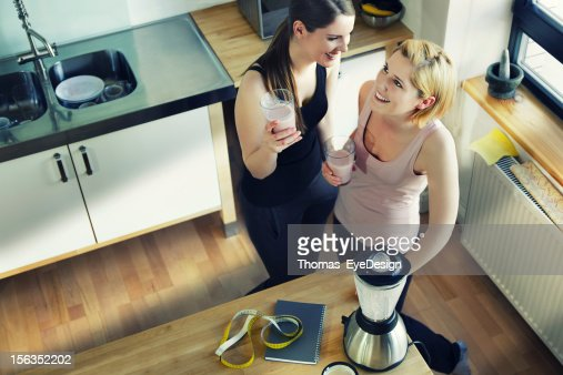 Two Women Enjoying a Meal Replacement Shakes : Stock Photo