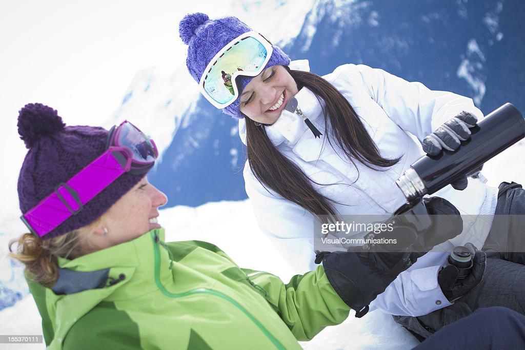 Two women enjoying tea in mountains. : Stock Photo