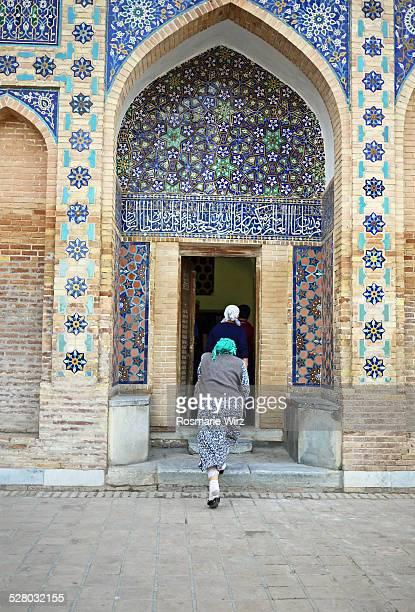 Two women entering mausoleum