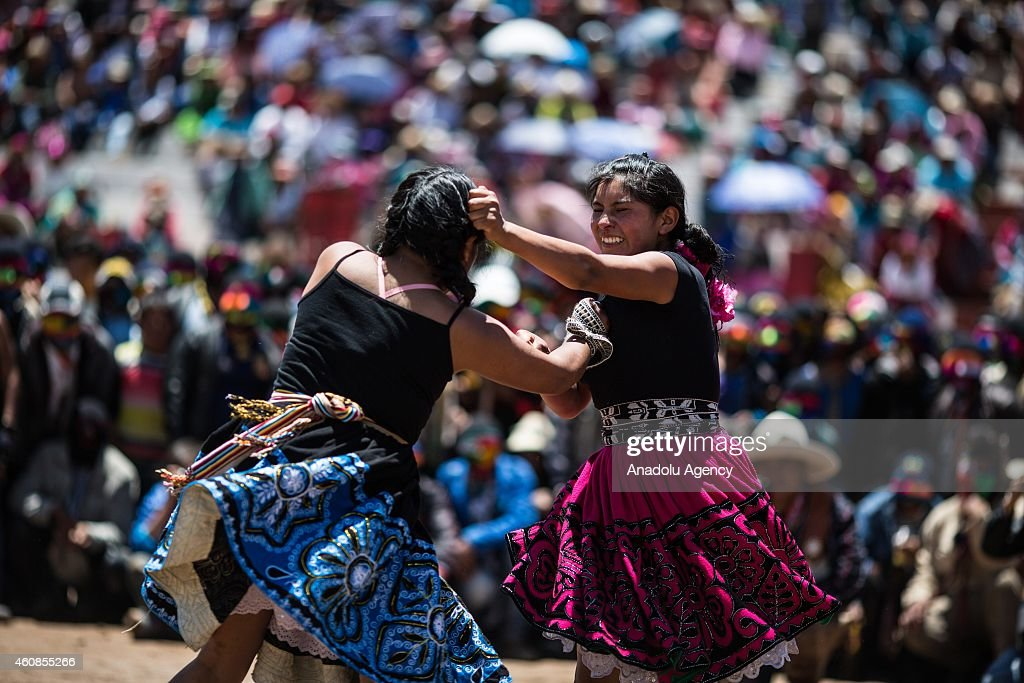 Two women fight during Takanakuy celebrations in the region of Chumbivilcas, Cuzco in the Andes of southern Peru on December 25, 2014. The Takanakuy is a traditional celebration held every December 25. The celebration can last many days. The word 'Takanakuy' means 'to strike with the fist' and fighters are heating with dances and songs called Wayliyas. Men and women who have had problems with other people during the year are fixing their conflicts at the end of the year with one or several fights. Usually, conflicts are raised by issues related to land or harvesting, stealing animals or insulting the name of the father. Some collisions are caused by love or friendship issues.