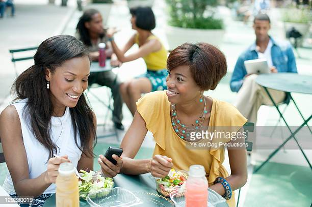 Two Women Friends Eating at Outdoor Cafe