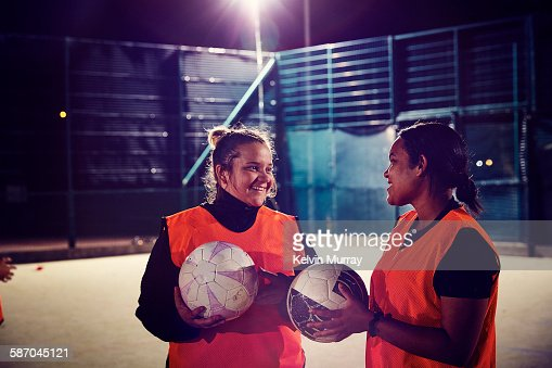 Two women from ladies football team smiling