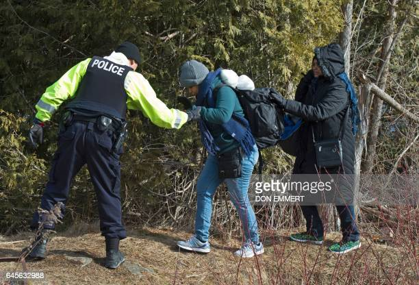 Two women from Sudan are helped by the RCMP at the US/Canada border February 26 in Champlain NY The women were arrested for crossing the border...