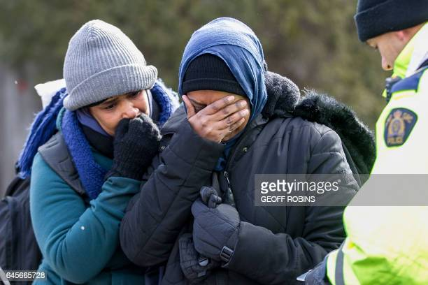 Two women from Sudan become emotional while being detained by the RCMP after they illegally crossed the CanadaUS border near Hemmingford Quebec...