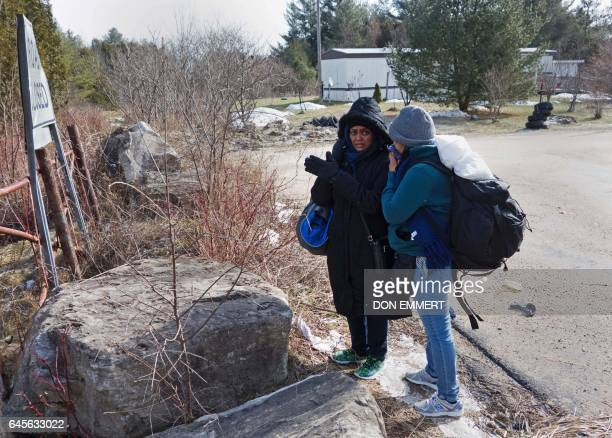 Two women from Sudan pause near the US/Canada border after they were warned by the RCMP that they would be arrested February 26 in Champlain NY...