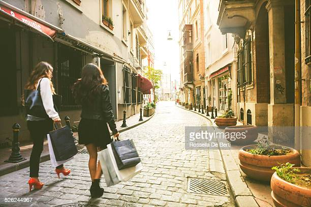 Two Women Hanging Around And Shopping