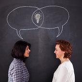 Two women having an idea
