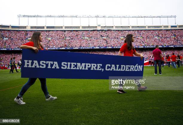 Two women hold a banner during the the farewell party of the Vicente Calderon stadium in Madrid on May 21 2017