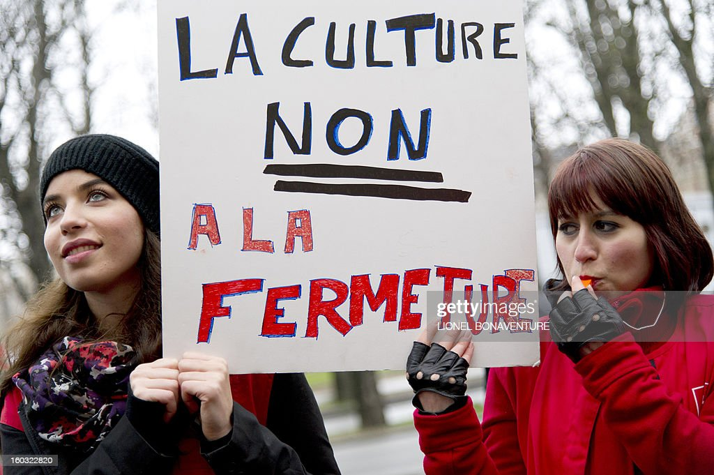 Two women hold a banner which reads 'Yes for the culture, no for the closing' as employees of the retailer Virgin France Megastore demonstrate in front of the store on the Champs-Elysees avenue, on Juanuary 29, 2013 in Paris. Megastore music and book unit, which is known in France as a 'culture' retailer, said two weeks ago it will file for insolvency. Originally started by Richard Branson, the British billionaire and chairman of the Virgin Group, the Virgin megastores were bought by the French Lagardere group in 2001 before French-American businessman Walter Butler became the majority shareholder. Butler announced on January 20, 2013, its failure to relaunch the stores.